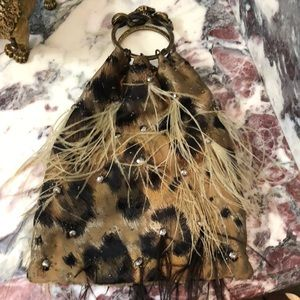 Valentino clutch is decorated w: ostrich